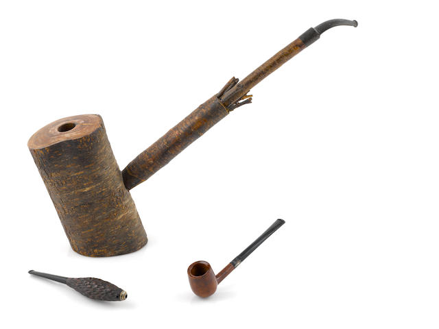 A GROUP OF TWO PIPES AND A PEACE PIPE