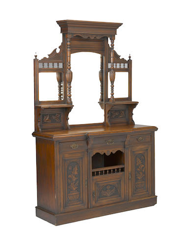 A Renaissance Revival walnut buffet a deux corps French or Belgian <BR />fourth quarter 19th century