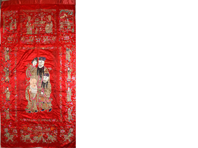 A Chinese red silk embroidered wall hanging 20th century