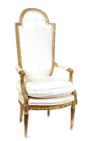 A Louis XVI style giltwood fauteuil