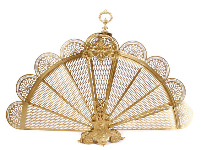 A Louis XV style gilt metal fan form folding fire screen