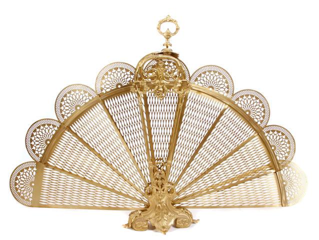A Louis XV style gilt metal fan form folding fire screen