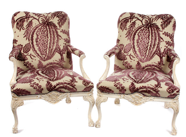 A pair of George III style white painted library armchairs