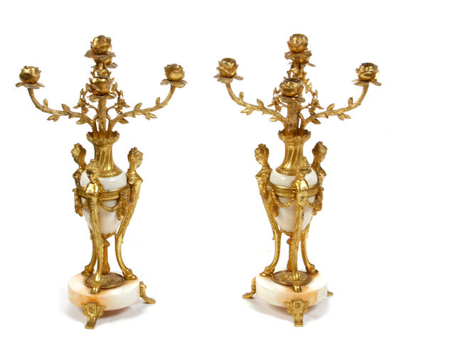 A pair of Louis XVI style gilt metal and marble five light candelabra