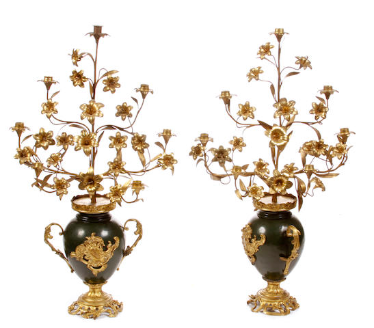 A pair of gilt and paint decorated metal seven light candelabra