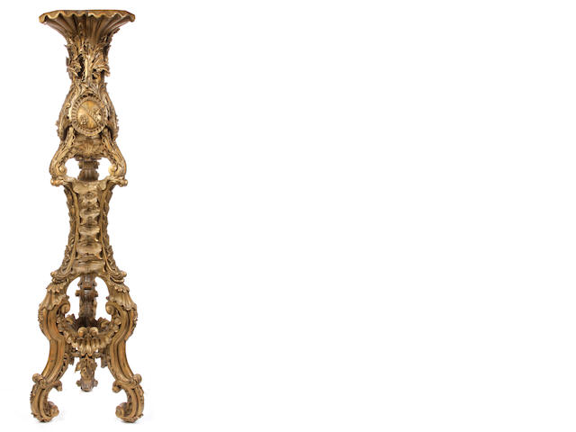 An imposing Baroque style parcel gilt carved wood pedestal