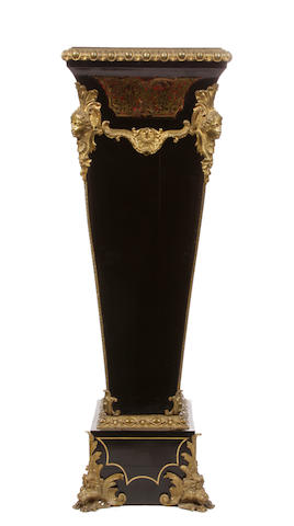 A Règence style gilt bronze mounted ebonized pedestal