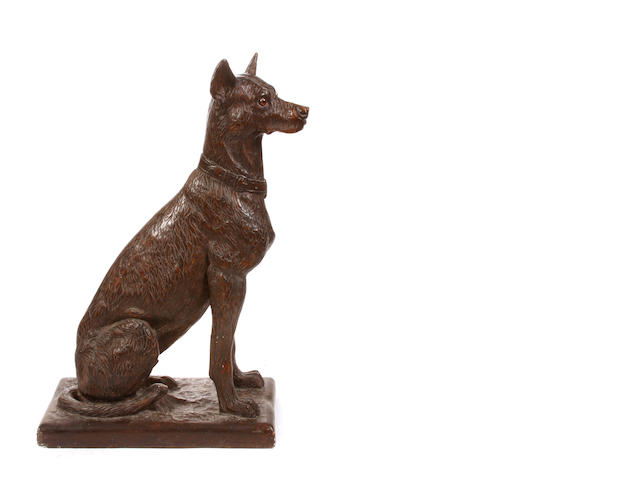 A Continental paint decorated plaster model of a seated hound