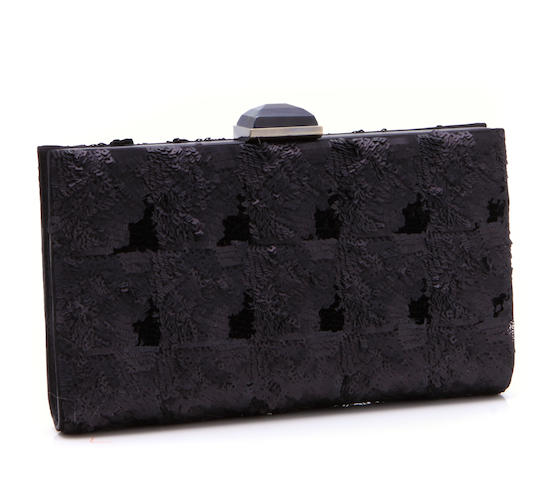 A Salvatore Ferragamo sequined black leather clutch