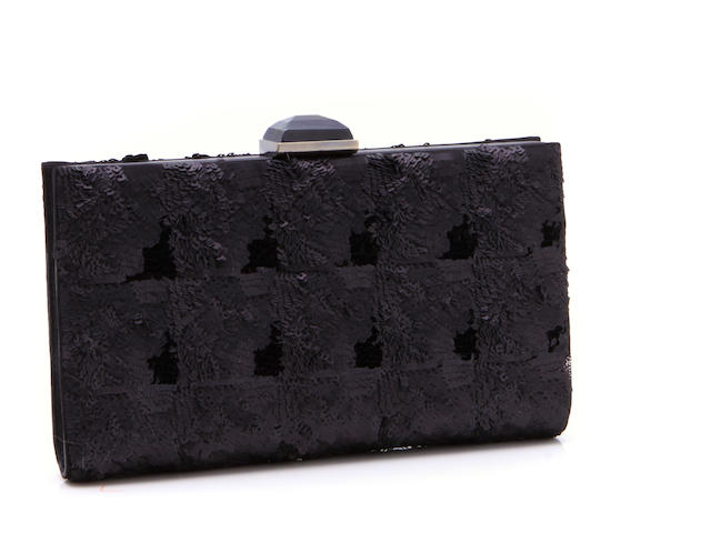 A Salvatore Ferregamo black sequin and leather clutch
