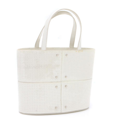 A Todd's ivory mini leather and tanslucent pillets handbag
