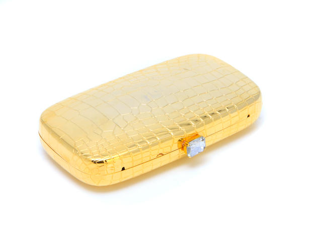 A gold Neiman Marcus Collection clutch