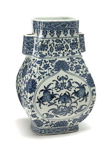 A blue and white porcelain hu for vase with nine peach and bat reserves on a lotus ground six character Qianlong seal mark, 20th century