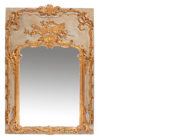 A Louis XV style parcel gilt and paint decorated mirror