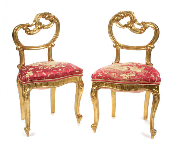 A pair of Italian Rococo style giltwood side chairs