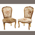 A pair of Louis XV style giltwood side chairs