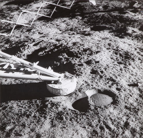 SURVEYOR III.  Gelatin silver print (490 x 490 mm sight) window-mounted,  of the number 2 footpad of Surveyor III taken by Alan Bean, November 20, 1969.