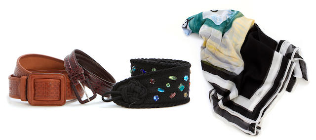 An assembled group of belts together with a Picasso scarf
