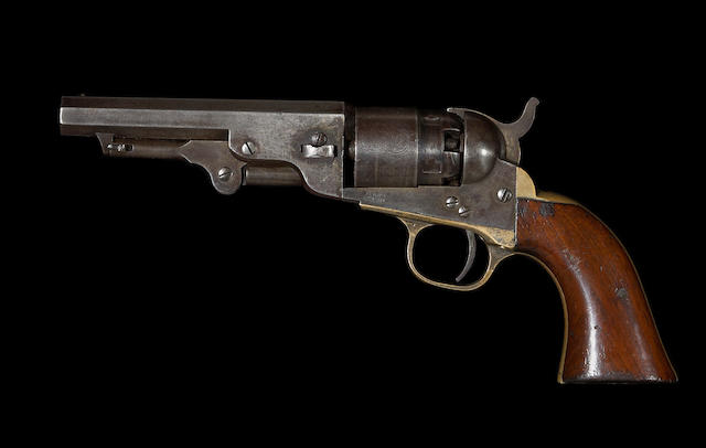 A Colt Model 1862 pocket navy percussion revolver.
