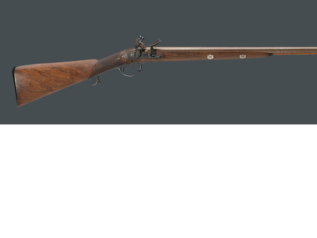 An English double barreled flintlock fowling gun by John Knubley