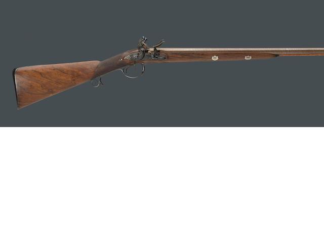 An English double barreled flintlock fowling gun by John Knubley
