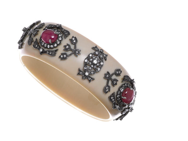 An ivory, ruby and diamond bangle bracelet
