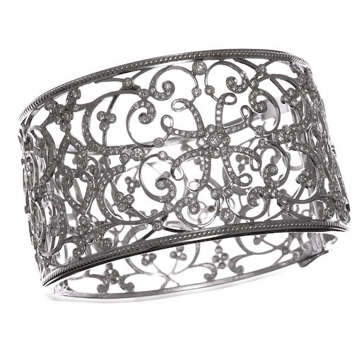 A diamond filigree bangle bracelet