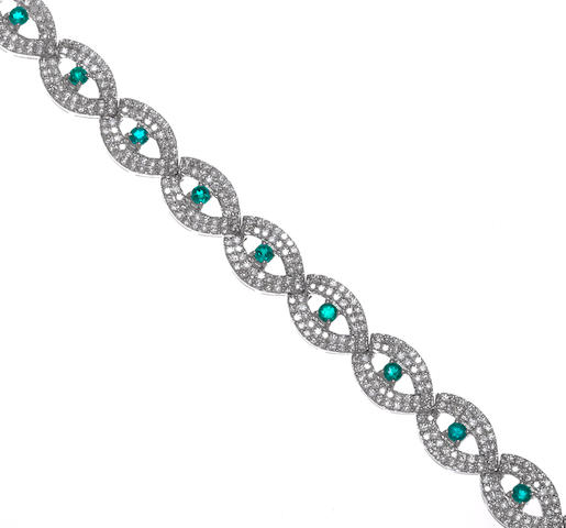 A diamond and emerald bracelet, 18k D=4.70ct E=1.50ct