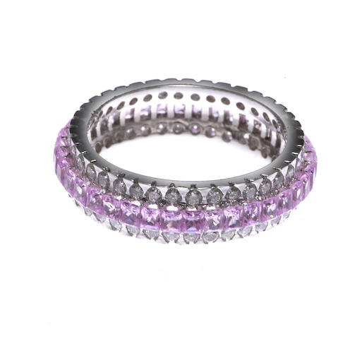 A pink sapphire and diamond eternity band