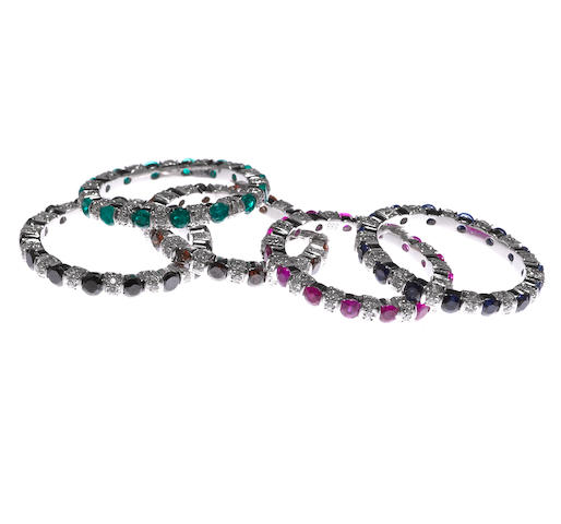 A set of five diamond, colored diamond and gem-set eternity bands