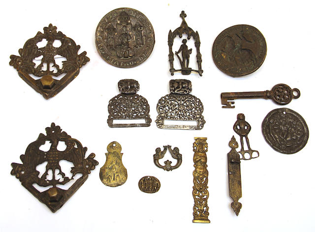 A group of fifteen metal seals, appliques and other articles 15th century and later