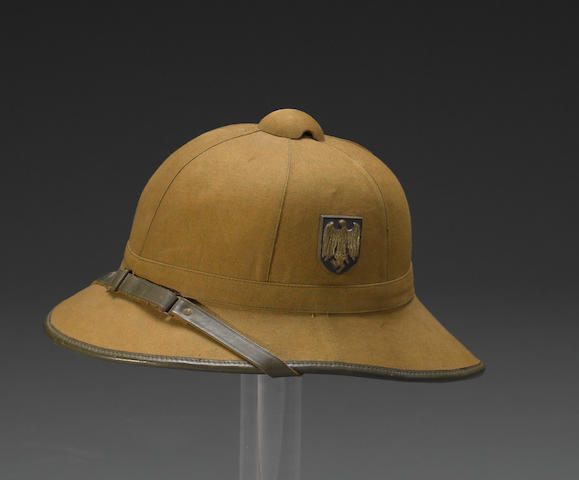 A German World War II First Pattern tropical helmet