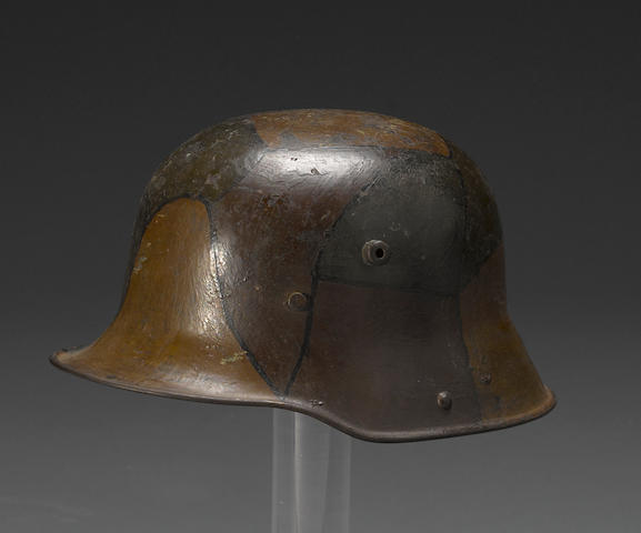 A German Model 1916 three-color camoflage helmet