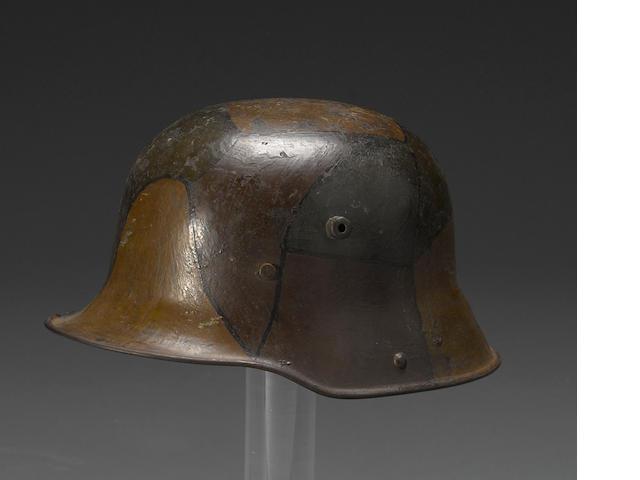 A German Model 1916 three-color camoflage helmet