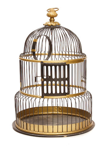 A gilt and paint decorated metal bird cage