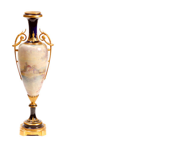 A Louis XV style gilt bronze mounted glazed earthenware urn
