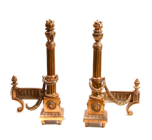 A pair of Louis XV style bronze columnar form chenets