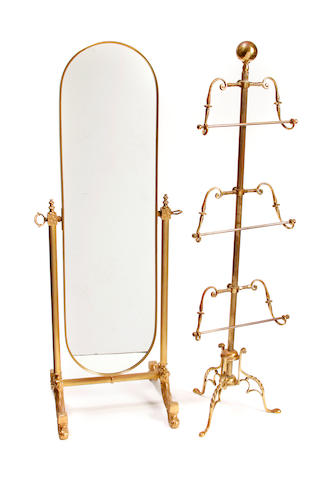 A brass three tier towel rack