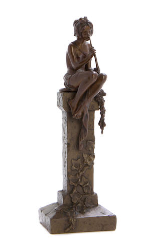A French patinated bronze figure of a nymph seated on a column