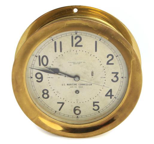 A Chelsea Clock Company brass bulkhead timepiece