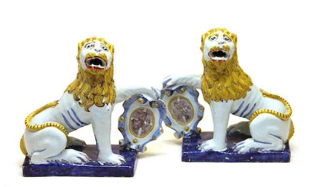 A pair of Luneville style faience heraldic lions 19th century