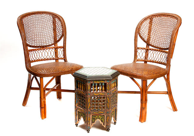 A set of four rattan and cane paneled chairs