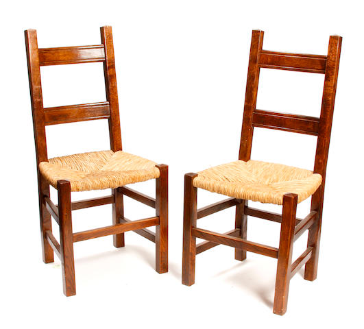 A set of six Arts and Crafts style  mixed wood rush seat chairs