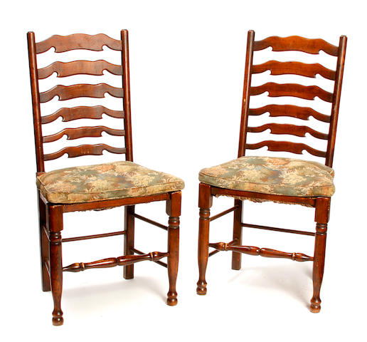 A set of eight George III style mixed wood ladderback chairs