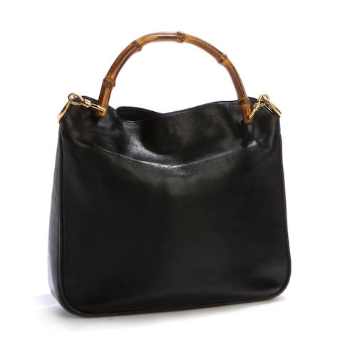 A Gucci black leather shoulderbag with bamboo handles