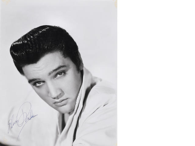 An Elvis Presley signed photograph, 1960-61