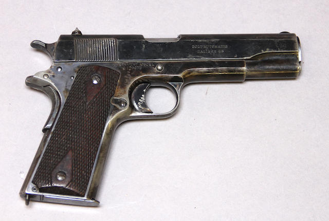 An early Colt Model 1911 commercial semi-automatic pistol