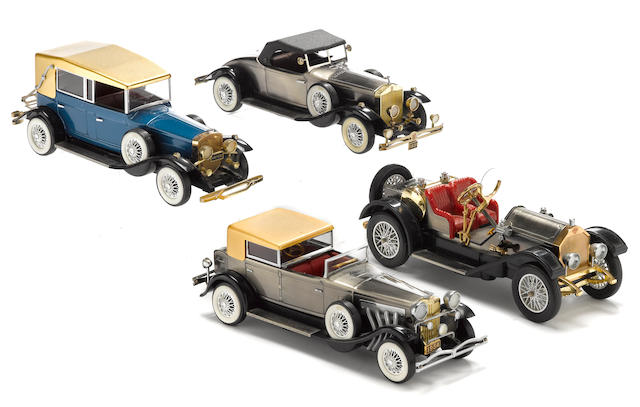 An ensamble of classic scale model automobile radios,