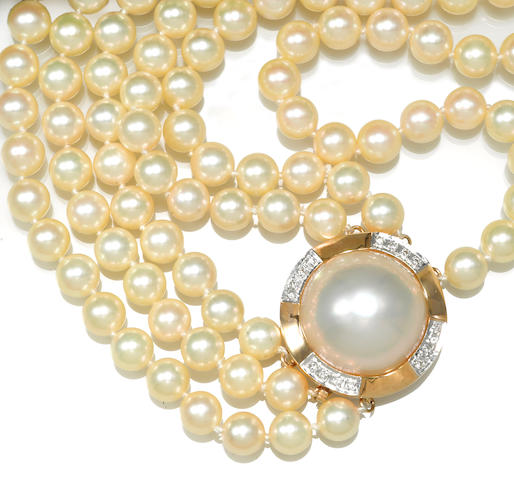 A cultured pearl, mabé cultured pearl and diamond three-strand necklace