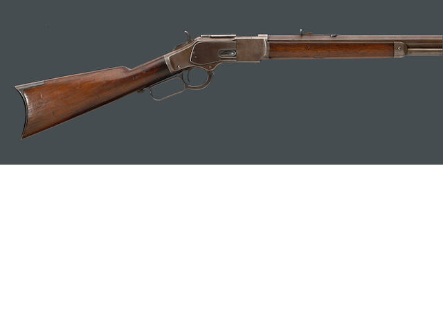 A Winchester Model 1873 lever action rifle